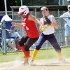 WARREN DILLAWAY / Star Beacon<br /> DONNA RICHARDSON (left) of Bucyrus arrives safely at third base as Katie Jo Hass reaches for the ball during major league all-star action during the Little League State Tournament at Cederquist Park in Ashtabula.