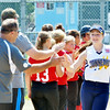 WARREN DILLAWAY / Star Beacon<br /> LILLIAN SPEES of Conneaut greets Bucyrus players and coaches prior to Little League State Tournament action on Saturday at Cederquist Park in Ashtabula.