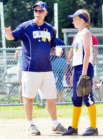 WARREN DILLAWAY / Star Beacon<br /> JOHN NOTTE, a Conneaut major league all-stars coach, talks with Katie Jo Hass prior to Saturday morning action with Bucyrus at Cederquist Park in Ashtabula.