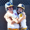 WARREN DILLAWAY / Star Beacon<br /> EMILY PRATT of Tallmadge (left) celebrates with teammate Melina Cioffi after Pratt scored on Monday evening during major league all-star action at the Ohio Little League State Tournament at Cederquist Park in Ashtabula.