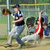 WARREN DILLAWAY / Star Beacon<br /> ALEX KENNEDY of Conneaut can't control the ball as Ben Scibani of United slides safely home during minor league    all-star action at Skippon Park in Conneaut.