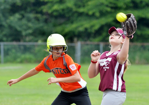WARREN DILLAWAY / Star Beacon<br /> ABBY CARTER of United (left) arrives safely at second while Carrie Clute of Pymatuning Valley grabs a late throw on Thursday during major league all-star action in Andover.