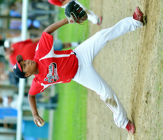 WARREN DILLAWAY / Star Beacon<br /> CHRISTIAN HALL of Jefferson pitches on Thursday evening in Andover during a minor league all-star game against Pymatuning Valley.