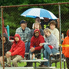 WARREN DILLAWAY / Star Beacon<br /> LITTLE LEAGUE fans try to stay dry in Andover during a minor league all-star game between Jefferson and Pymatuning Valley.