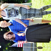 WARREN DILLAWAY / Star Beacon<br /> MAGGIE STASIAK (left) , Andrew Root and Hannah Root prepare to unveil a new tombstone for distant relative Seth Hillyer who served inn the Revolutionary War. The ceremony was sponsored by the Northeast Ohio Chapter of the Sons of the American Revolution and held at Andover Congregational Church Cemetery.