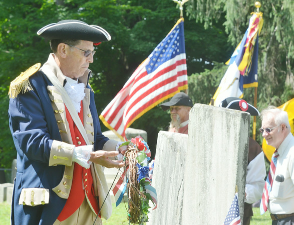 WARREN DILLAWAY / Star Beacon<br /> MEMBERS OF the Northeastern Ohio Chapter of the Sons of the American Revolutionary War led a grave marking ceremony for Revolutionary War veterans at four Ashtabula County ceremonies on Friday.