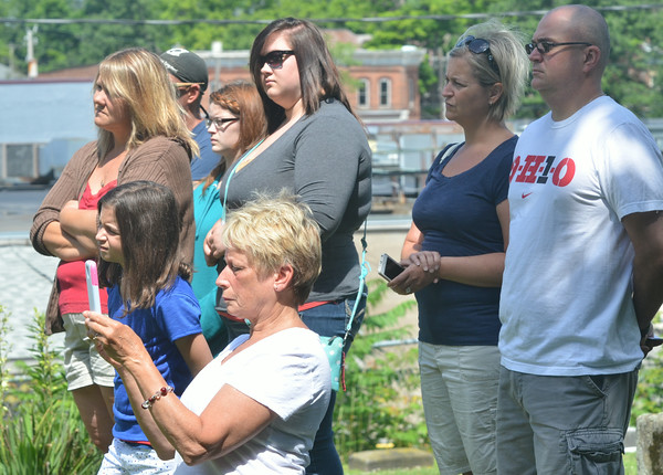 WARREN DILLAWAY / Star Beacon<br /> MORE THAN 50 people attended a Revolutionary War Soldiers Grave Marking Ceremony at the Andover Congregational Church Cemetery on Friday morning. The event was sponsored by the Northeastern Ohio Chapter of the Sons of the American Revolution.