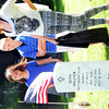 WARREN DILLAWAY / Star Beacon<br /> MAGGIE STASIAK (left) , Andrew Root and Hannah Root unveiled a new tombstone for distant relative Seth Hillyer who served in the Revolutionary War. The ceremony was sponsored by the Northeast Ohio Chapter of the Sons of the American Revolution and held at Andover Congregational Church Cemetery.
