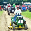 "WARREN DILLAWAY / Star Beacon<br /> ROBERT ""BO"" SEMAI of Wayne Township participates in a parade at the Ashtabula County Antique Engine Club Show in Wayne Township on Saturday."