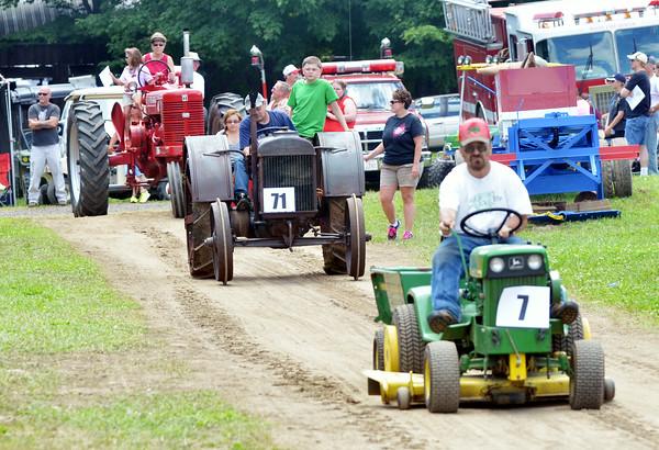 "WARREN DILLAWAY / Star Beacon<br /> ROBERT ""BO"" SEMAI of Wayne Township participates in a parade at the Ashtabula County Engine Club Show in Wayne Township on Saturday."