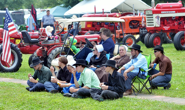 WARREN DILLAWAY / Star Beacon<br /> CROWDS OF people enjoyed a parade at the Ashtabula County Engine Antique Club Show in Wayne Township on Saturday.