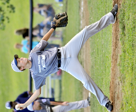 WARREN DILLAWAY / Star Beacon<br /> BRYCE BOGDAN of pitches for Grand Valley on Monday during major league all-star action at Skippon Park in Conneaut.