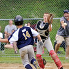 WARREN DILLAWAY / Star Beacon<br /> GARY GHIZ (14) of Conneaut as the ball flies by Gordon Seger, Grand Valley catcher, during major league all-star action at Skippon Park in Conneaut on Monday evening.