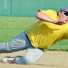 WARREN DILLAWAY / Star Beacon<br /> JUSTIN ADAMS of Geneva dives for a throw during the Ashtabula County Senior All Star Game on Monday at Havens Complex in Jefferson Township.