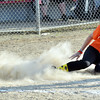 WARREN DILLAWAY / Star Beacon<br /> KAITLYN FRYE of BiLo kicks up a cloud of dust on Thursday night during Senior League action at the Jefferson Area Girls Softball Complex.