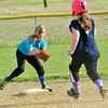 WARREN DILLAWAY / Star Beacon<br /> SIERRA SZUHAY (left) of Penco prepares to tag out Emily Forman of Medico (right) during a Major League game at the Jefferson Area Girls Softball Complex.