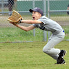 WARREN DILLAWAY / Star Beacon<br /> JOSH COLE of the Yankees prepares to make a lunging catch during Major League action at Ashtabula's Cederquist Park on Friday evening,