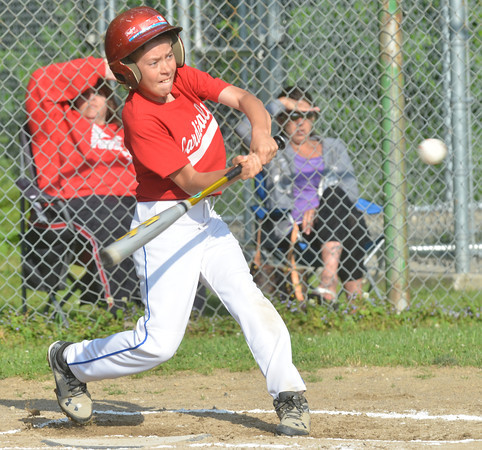 WARREN DILLAWAY / Star Beacon<br /> ZACH GRIFFITH of the Cardinals takes a mighty swing during Ashtabula Major League action at Cederquist Park in Ashtabula on Friday night.