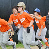WARREN DILLAWAY / Star Beacon<br /> JONAH ANSERVITZ (center with glasses and light helmet) gets runs off the field with  Marlins teammates after hitting a home run during Major League action at Ashtabula's Cederquist Park on Friday evenning.