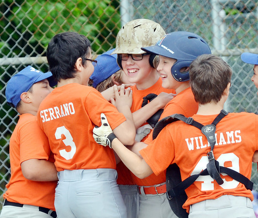 WARREN DILLAWAY / Star Beacon<br /> JONAH ANSERVITZ (center with glasses and light helmet) gets mobbed by Marlins teammates after hitting a home run during Major League action at Ashtabula's Cederquisst Park on Friday evenning.