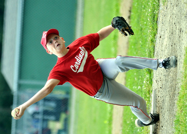 WARREN DILLAWAY / Star Beacon<br /> ALEC RADWANCKY of the Cardinals pitches during Ashtabula Major League action at Cederquist Park on Friday evening.
