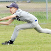 WARREN DILLAWAY / Star Beacon<br /> JOSH COLE of the Yankees prepares to make a lunging catch during Major League action at Ashtabula's Cederquist Park on Friday evening.