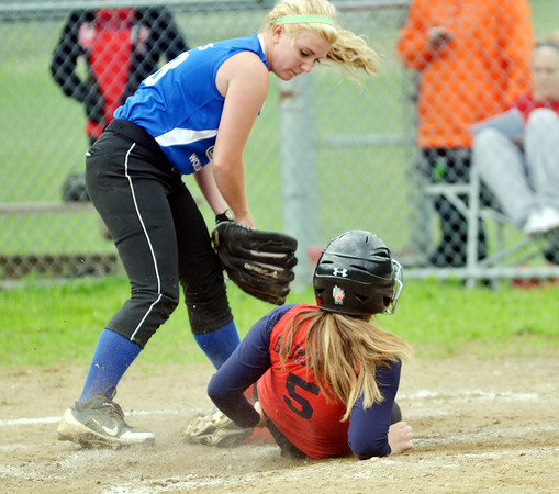 WARREN DILLAWAY / Star Beacon<br /> ABBY TAKACS of Grand Valley (standing) applies a late tag to Kayleigh  Baumgartner as she slides safely home during Junior League action at Cederquist Park in Ashtabula on Friday evening.