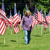 CATHY LEONARD of Pierpont Township walks among the Fields of Honor on Saturday in North Kingsville.