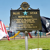 WARREN DILLAWAY / Star Beacon<br /> MICKIE MARQUIS, Garden Club President of Ohio, (left) and DiAnna Kondas, president of the Garden Trails Garden Club, unveil a Blue Star Memorial on Saturday afternoon at Lake Shore Park in Ashtabula Township.
