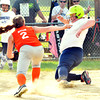 WARREN DILLAWAY / Star Beacon<br /> BRIANNA STRADDER of Conneaut slides safely home on Monday evening during Minor League action at Orwell Community Park as Riley Pucel of the Grand Valley Orange Crush applies a late tag.