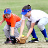 WARREN DILLAWAY / Star BeacoN<br /> MADDIE BOVEE (left) and Mets teammate Kylie Burke work together to field a Saybrook Minor League game with the White Sox on Tuesday evening.