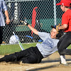 WARREN DILLAWAY / Star Beacon<br /> BEN CLEVELAND of the Twins slides safely home as Chse Dickson of the Cardinals arrives to cover home plate  during Jefferson Minor League action on Tuesday at Havens Complex in Jefferson Township.