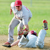WARREN DILLAWAY / Star Beacon<br /> BRANDON AEBIE of the Munson  14 and under team  tags out Seth Schrock of the Geneva 14 and under Raptors at Kosicek Field in Harpersfield Township on Thursday evening.