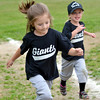 WARREN DILLAWAY / Star Beacon<br /> JULIA TRASK (left) and Ashtabula Tee Ball Giant teammate Shelby Tackett run around the bases after a game at Cederquist Park in Ashtabula.