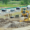 WARREN DILLAWAY / Star Beacon<br /> CONSTRUCTION CREWS work on Interstate 90 at the Austinburg Township entrance ramp on Friday afternoon.