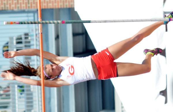 WARREN DILLAWAY / Star Beacon<br /> ALLY THOMPSON of Geneva clears opening height during the Division I pole vault competition at the Ohio High School Athletic Association State Track Meet in Columbus on Saturday.