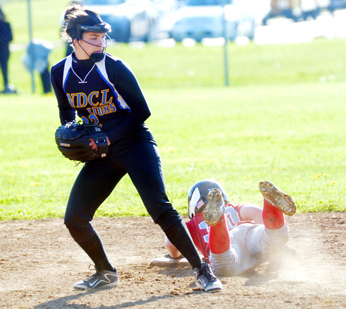 WARREN DILLAWAY / Star Beacon<br /> CAMILLE POLLUTRO of Notre Dame Cathedral Latin grabs a late throw as Taylor Rowe of Edgewood slides safely in to second base on Friday.
