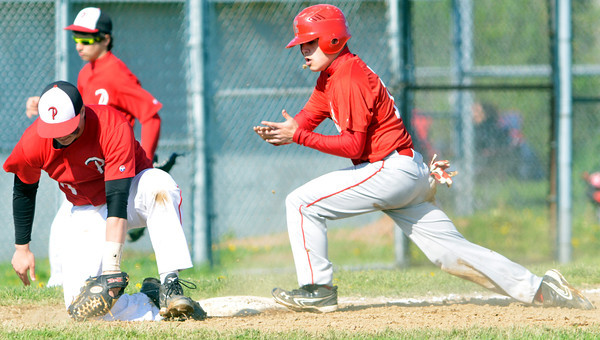 WARREN DILLAWAY / Star Beacon<br /> ANDREW GRAEB (right) of Edgewood arrives safely at third base as Tyler Zaletel of Perry reaches for the ball on Friday at Edgewood during a Division II Sectional Champioship game.