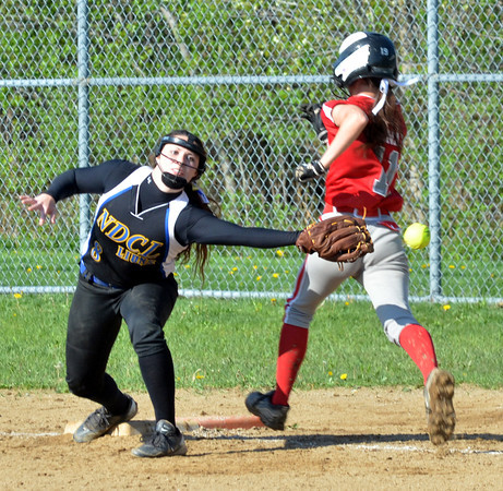 WARREN DILLAWAY / Star Beacon<br /> COURTNEY DIDONATO (right) of Edgewood arrives safely at second base as Samantha Flowers of Notre Dame Cathedral Latin reaches for an errant throw on Friday afternoon during a Division II sectional championship game at Edgewood.