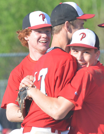 WARREN DILLAWAY / Star Beacon<br /> NICK ADAMIK (right) hugs Perry teammate Cody Ewing as M.J. Reed smiles in the background after the Pirates clinched a Division II sectional championship game at Edgewood.