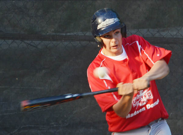 WARREN DILLAWAY / Star Beacon<br /> TREY THORNTON of the United Junior League team takes a swing on Monday during a game with Painesville at Kiwanis Park in Geneva.