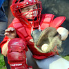 WARREN DILLAWAY / Star Beacon<br /> DUST IS knocked from the glove of Cameron DeLuca on Monday evening during Junior League action with Painesville at Kiwanis Park in Geneva.