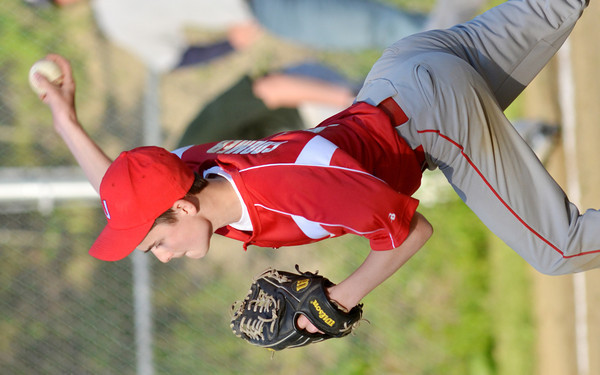 WARREN DILLAWAY / Star Beacon<br /> DYLAN COOMER pitches for the United Junior League team on Monday evening against Painesville at Kiwanis Park in Geneva.