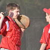 WARREN DILLAWAY / Star Beacon<br /> CAMERON DELUCA (left) of the United Junior League team talks with pitcher Dylan Coomer during action at Kiwanis Park in Geneva on Monday evening.