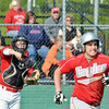 WARREN DILLAWAY / Star Beacon<br /> RYAN NAPPI of Geneva (right) dashes to first base as Perry catcher Tim Somogyi throws to first base on Tuesday during Division II district semifinal action against Perry at Jefferson.