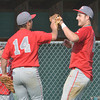 WARREN DILLAWAY / Star Beacon<br /> JOSE SANCHEZ (left) and Geneva teammate Ryan Nappi celebrate between innings on Tuesday during Division II district semifinal action against Perry at Jefferson.
