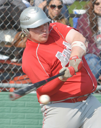 WARREN DILLAWAY / Star Beacon<br /> JUSTIN ADAMS of Geneva swings on Tuesday during a Division II district semifinal action against Perry at Jefferson.