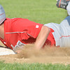 WARREN DILLAWAY / Star Beacon<br /> JOSE SANCHEZ of Geneva dives safely back to first base on Tuesday during Division II district semifinal action against Perry at Jefferson.