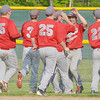 WARREN DILLAWAY / Star Beacon<br /> JOSE SANCHEZ of Geneva (facing) celebrates with teammates after pitching and hitting his team to victory  on Tuesday during Division II district semifinal action against Perry at Jefferson.