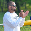 WARREN DILLAWAY / Star Beacon<br /> NICK ARMENI, Conneaut softball coach, claps for his team  on Thursday during a Division II district semifinal  at the Jefferson Area Girls Softball Complex.